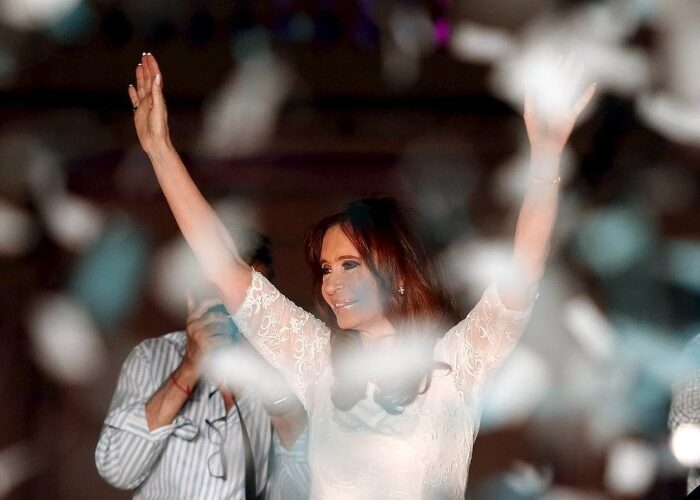 Argentina's President Cristina Fernandez de Kirchner waves to supporters after giving her final speech during a rally in front of  the Casa Rosada Presidential Palace in Buenos Aires, Argentina, December 9, 2015. REUTERS/Andres Stapff